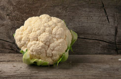 Raw cauliflower on wooden background. With copy space Royalty Free Stock Photo