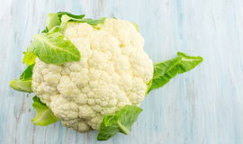 Raw cauliflower on a wooden table Royalty Free Stock Image