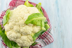 Raw cauliflower on a wooden table. Healthy eating Stock Image