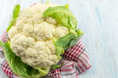 Raw cauliflower on a wooden table. Healthy eating Stock Photography