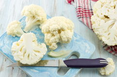 Raw cauliflower on a wooden table. Raw cauliflower sliced on a wooden table. Healthy eating Royalty Free Stock Photos