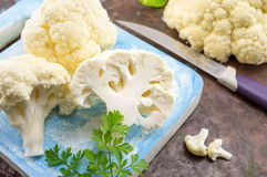 Raw cauliflower on a wooden table. Raw cauliflower sliced on a wooden table. Healthy eating Stock Image