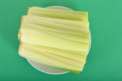 Raw Celery Sticks on a Plate Stock Photo