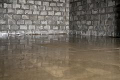 Raw cement screed in studio being repared Stock Photo