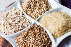 Raw cereals,buckwheat, oats, pearl barley, white rice Royalty Free Stock Images