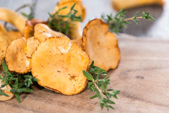 Raw Chanterelles. Portion of raw Chanterelles on vintage wooden background Stock Image