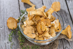Raw Chanterelles on wood. Raw Chanterelles on vintage wooden background Royalty Free Stock Image