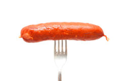 Raw cheese kransky hotdog on fork Stock Photo