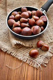 Raw chestnut in a pan Stock Photo