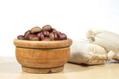 Raw chestnuts beside sacks of chestnut flour Royalty Free Stock Images