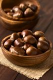 Raw Chestnuts in Wooden Bowl Stock Photography