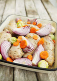 Raw chicken on a baking pan Royalty Free Stock Photography