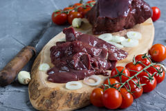 Raw chicken and beef liver. On board on stone table. Selective focus Royalty Free Stock Photography