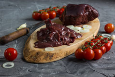 Raw chicken and beef liver. On board on stone table. Selective focus Royalty Free Stock Photo