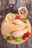 Raw chicken on board Stock Photo