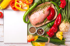 Raw chicken breast fillets with vegetables ingredients in pan Royalty Free Stock Photography