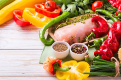 Raw chicken breast fillets with vegetables ingredients in pan Royalty Free Stock Images
