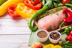 Raw chicken breast fillets with vegetables ingredients in pan Stock Images