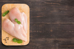Raw chicken breast fillets on wooden background with a lot of co Royalty Free Stock Photos