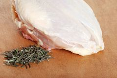 Raw chicken breast with fresh rosemary Stock Image