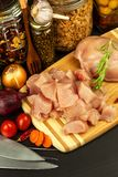 Raw chicken breast on the kitchen board. Diet food. Sale of meat. Spices for preparing meat on grill. Raw chicken breast on the kitchen board. Diet food. Sale Stock Photos