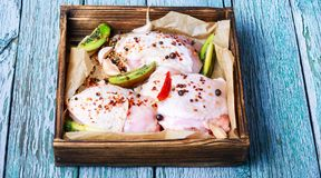 Raw chicken meat. Raw chicken breast in spices on a wooden tray.Chicken meat royalty free stock images