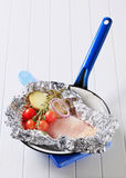 Raw chicken breast and vegetables in tinfoil Stock Photos