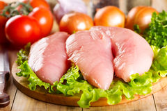 Raw chicken breast with vegetables Royalty Free Stock Photo