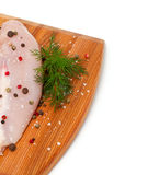 Raw chicken breast on wooden board Royalty Free Stock Photo