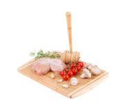 Raw chicken breast on the wooden board. Royalty Free Stock Photo