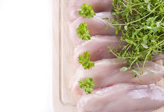 Raw chicken breasts on chopping board Royalty Free Stock Photo