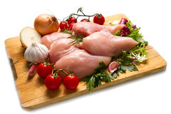 Raw chicken breasts on cutting board Royalty Free Stock Image