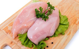 Raw chicken breasts. Fresh raw chicken breasts at wooden cutting board Stock Image