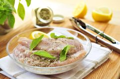 Raw chicken breasts marinating Royalty Free Stock Image