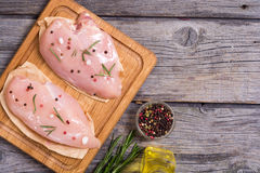 Raw chicken breasts. And spices on  cutting board. Top view , copy space Stock Photos