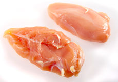 Raw chicken breasts on white Stock Images
