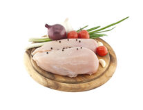 Raw chicken breasts on wooden cutting board with vegetable, isol. Ated on white background Stock Photos