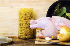 Raw chicken carcass and vegetables Royalty Free Stock Image