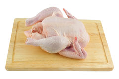 Raw chicken on chopping board Stock Image