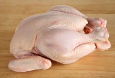 Raw chicken on a chopping board Royalty Free Stock Photography