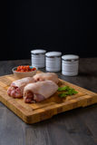 Raw chicken on a cutting board Stock Images