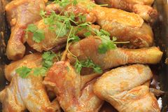 Raw Chicken drum stick with herb. Lots of Raw Chicken drum stick with herb in supermarket Stock Image