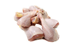Raw Chicken drumstick rests. On a white background Stock Photo