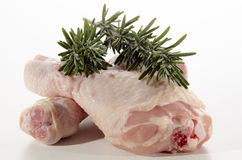 Raw chicken drumstick with rosemary Stock Photos