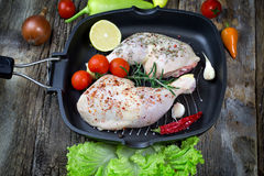 Raw chicken drumstick with spices (seasoning) in pan. Chicken raw meat ready to prepare meal Stock Photo