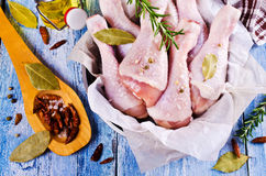Raw chicken drumstick. With spices on a wooden background. Selective focus Stock Photography