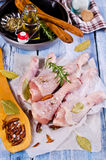 Raw chicken drumstick. With spices on a wooden background. Selective focus Stock Photos