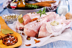 Raw chicken drumstick. With spices on a wooden background. Selective focus Royalty Free Stock Images