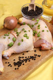 Raw   chicken drumstick with spring onion Stock Photo