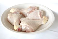 Raw chicken drumsticks Stock Photography